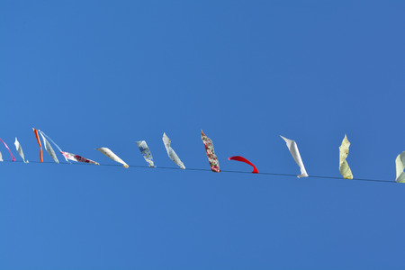 The beauty of the flag in the carnival. And traditions. Rural Thailand Blue sky is the background.