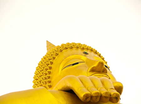 Golden Buddha on a white background.Focus on hands and eyes.