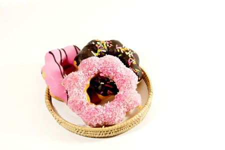 The beauty of colorful donuts on a dazzling white background.