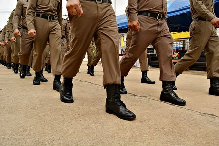 Thai police are not defeated by any nation in the world, Thai police are walking around the legs and feet. 写真素材