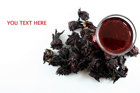 pile of Roselle and juice on white background photo