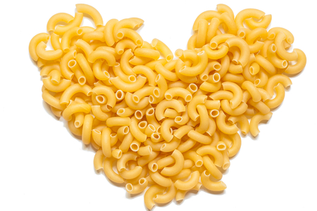 Italian pasta in the form of heart over white  Italian food background for Valentine photo