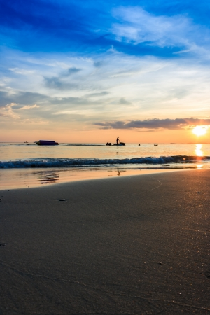 forground: Banana boat in evening before sunset with beach forground Stock Photo