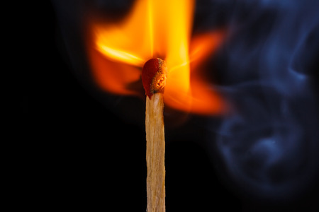 macro shot of a flaming matchstick
