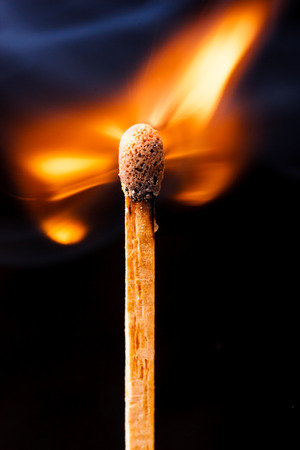 burning wooden kitchen matchstick ignition on black background macro photography