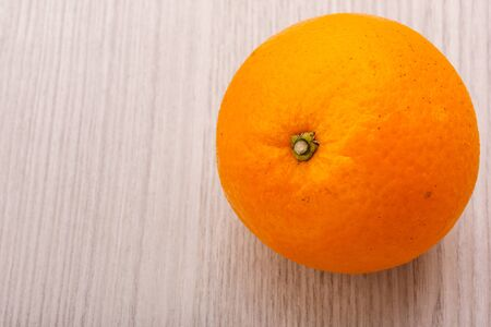 valencia orange or navel orange on wood   background