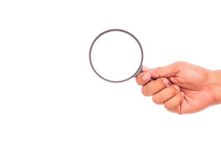 hand holding hand magnifying glass