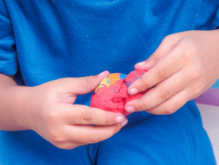closeup of child play modeling clay