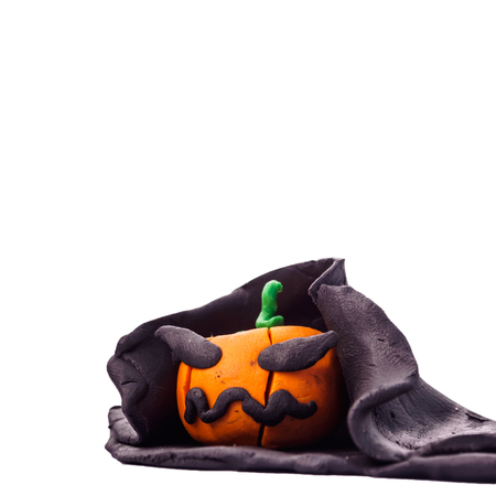 halloween pumpkins  create from modeling clay isolated on white background