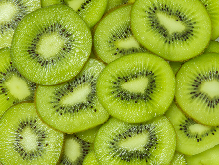 Kiwi sliced for background Stock Photo