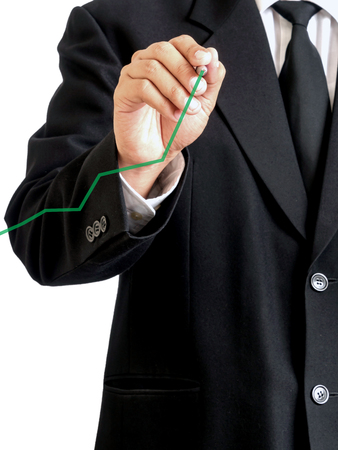 businessman drawing line graph. Stock Photo