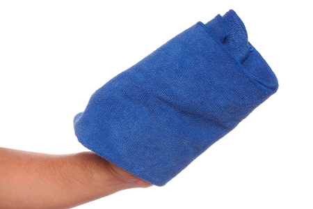 hand holding blue microfiber cloth for cleaner isolate on white background Stock Photo