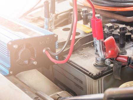 Charging battery car with electricity trough jumper cables,Selective Focus. Banco de Imagens - 100282452