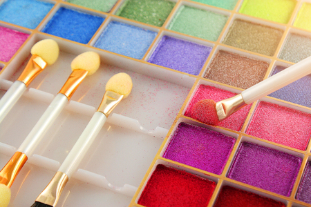 Makeup brushes and make-up eye shadows color palette.
