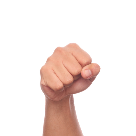 Male clenched fist isolated on white background with clipping path.