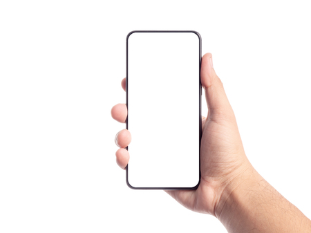 Male hand holding smartphone with blank white screen isolated background.mockup display concept. Banco de Imagens
