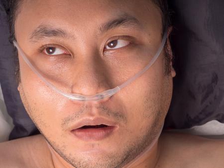 closeup of male patient with oxygen tube. Banco de Imagens