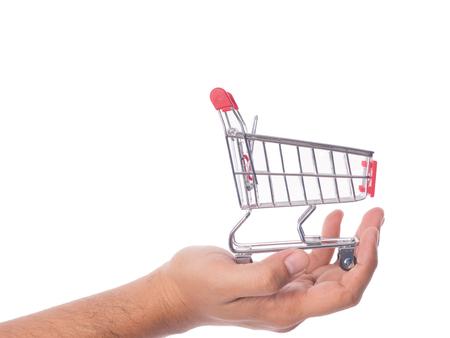 mini shopping cart in male hand. Banco de Imagens