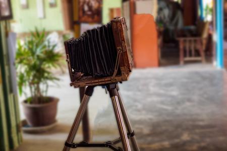vintage camera on tripod.