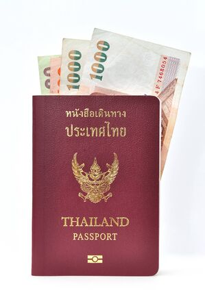 Thailand passport with banknotes Stock Photo