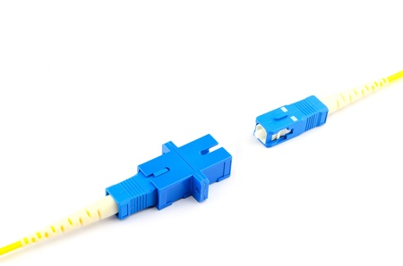 fiber optic connection sc connector with adapter on white background  photo