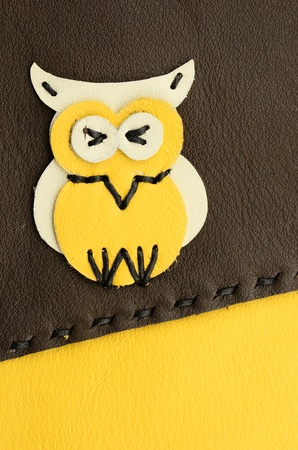 owl cartoon handmade from leather  photo