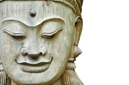 Part of a wooden figure face