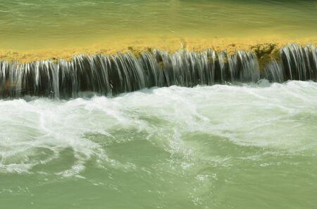 beautiful waterfall and green water photo