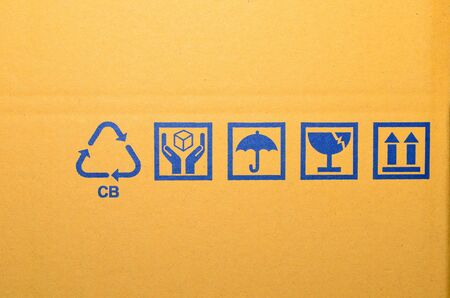 blue fragile symbol on cardboard box Stock Photo