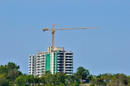 buildings under construction with cranes against a blue sky photo