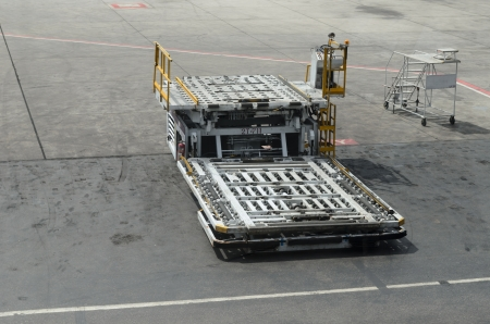 Empty luggage trolleys at airport transporting baggage photo