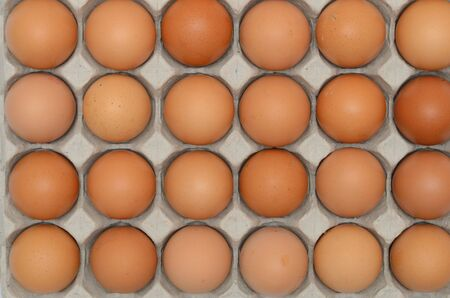 Eggs in a carton closeup view background photo