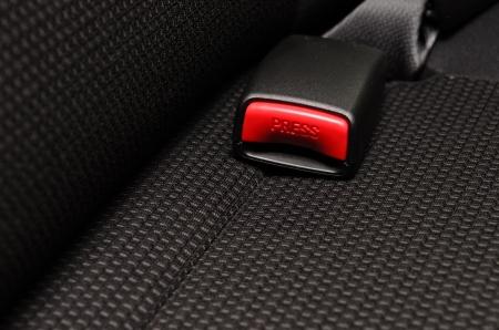señal de transito: cerca del cinturón de seguridad en un coche Foto de archivo