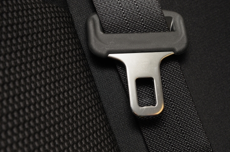 safe driving: close up safety belt in a car