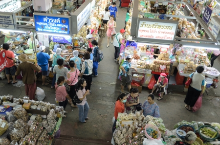 CHIANG MAI, THAILAND - Oct 26: Unidentified shoppers at Warorot market on Oct 26, 2012 in Chiang Mai, Thailand. The market has been in operation since 1910.