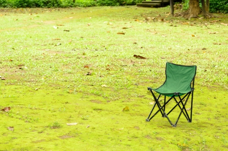 Green camping chair on green grass photo