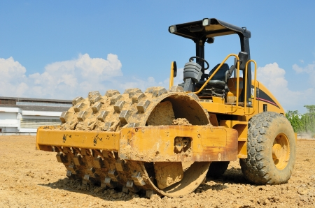 roll compactor attachment working at construction site Stock Photo - 16415381