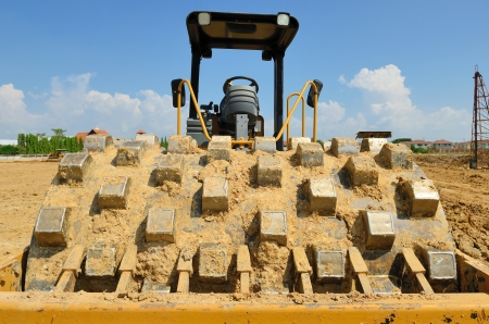 vibroroller: roll compactor attachment working at construction site