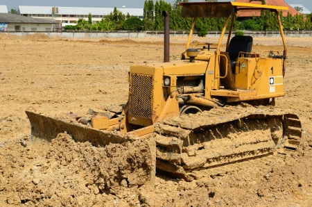 road grader bulldozer at construction site photo