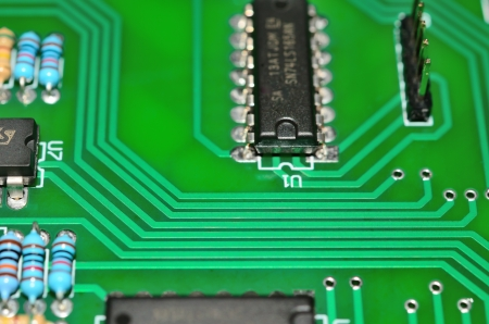 Detail of an electronic printed circuit board with many electrical components photo