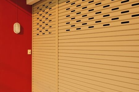 The beige shutter steel door for home security photo