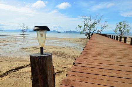 Ecology, solar lamp on wood bridge