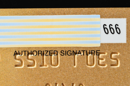 Close up of golden credit card with CVC number photo