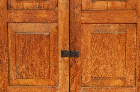 Locked old wooden door made from planks Stock Photo