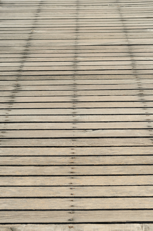 Brown wooden bridge background at sea