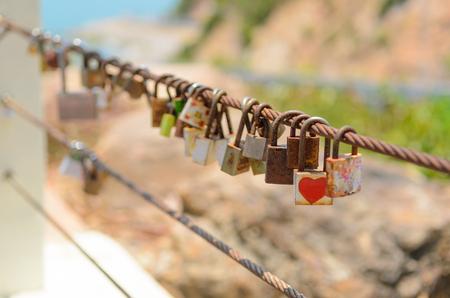 Many Love locks on fence symbol of eternal love, friendship and romance. Stock Photo
