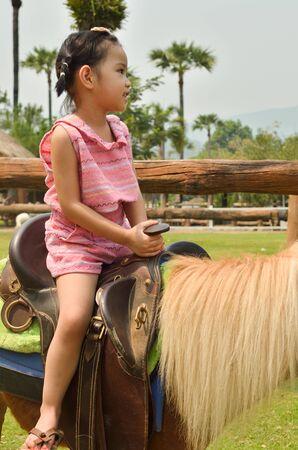Happy Asian Children playing in farm