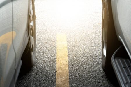 Two car on the asphalt road or in parking area. Prepare for race with yellow line. Standard-Bild
