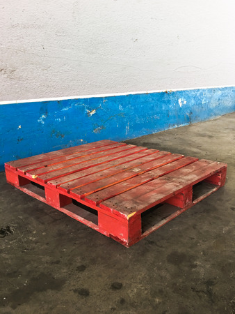 Old red wood pallet on in in industry