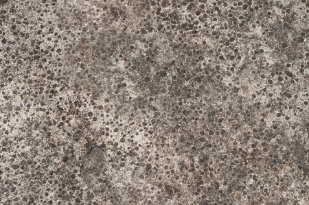 Concrete floor surface with crater cement.